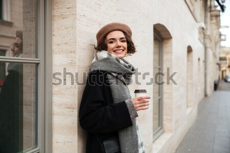 Young woman thinking while using smartphone Stock photo © deandrobot