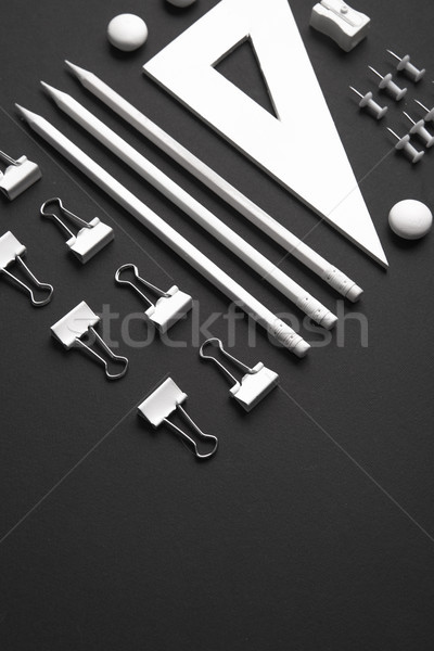 Office supplies on the black background table Stock photo © deandrobot