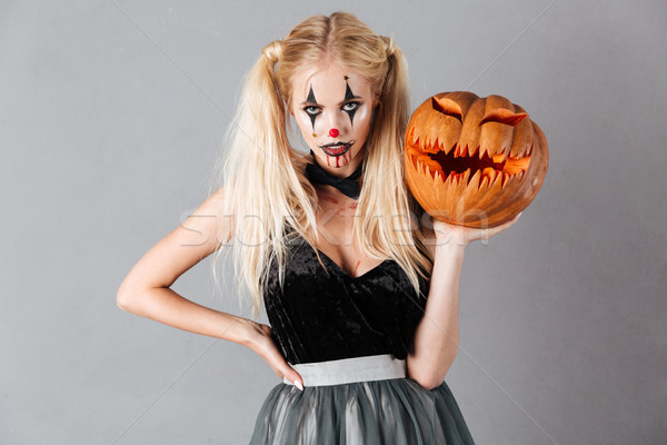Attractive blonde woman in halloween clown make-up Stock photo © deandrobot