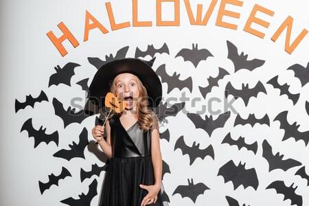 Vrouw heks halloween kostuum tonen tong Stockfoto © deandrobot