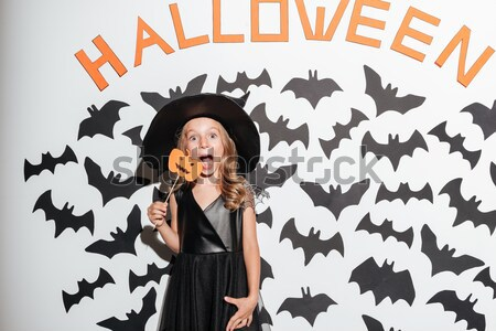 Mujer bruja halloween traje lengua Foto stock © deandrobot