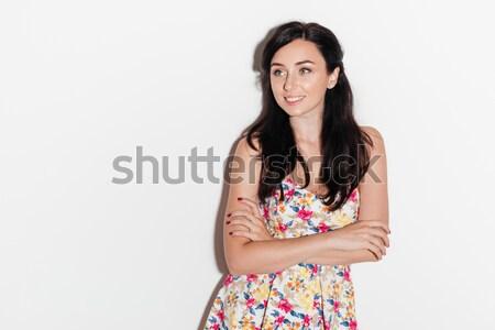 Feliz surpreendido morena mulher posando estúdio Foto stock © deandrobot