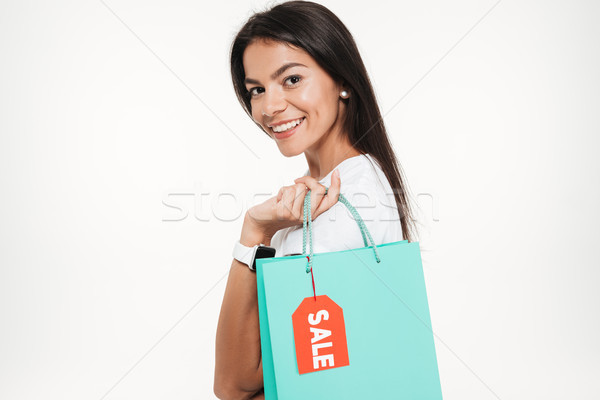 Close up portrait of a smiling woman holding shopping bag Stock photo © deandrobot