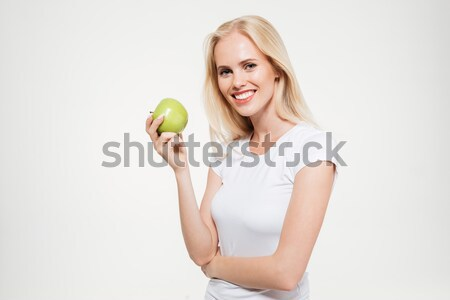 Portrait of a happy pretty woman holding green apple Stock photo © deandrobot