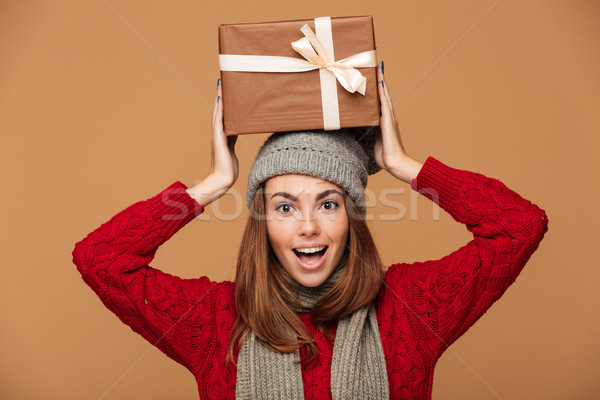 Happy exited young brunette woman in woolen hat  and knitted swe Stock photo © deandrobot