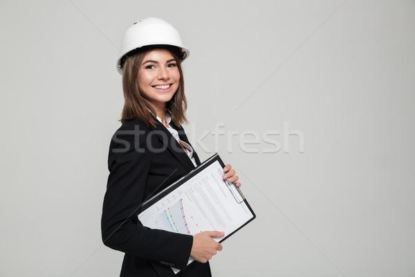 Portré boldog mosolygó nő védősisak öltöny néz Stock fotó © deandrobot