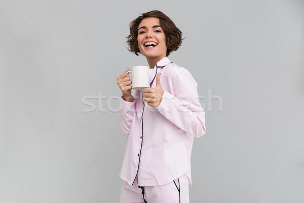 портрет счастливая девушка пижама Кубок счастливым Сток-фото © deandrobot