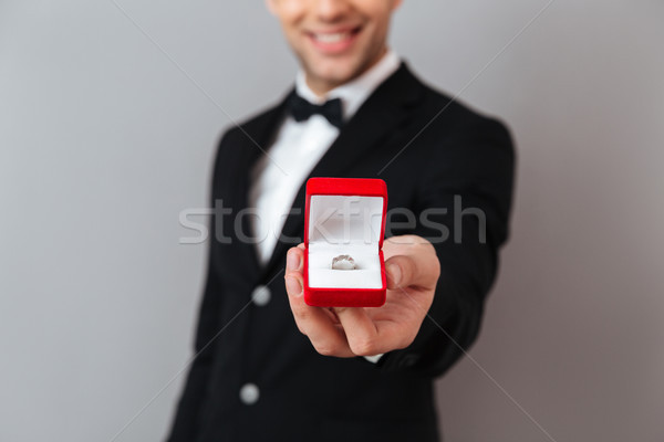 Close up portrait of a smiling man dressed in tuxedo Stock photo © deandrobot