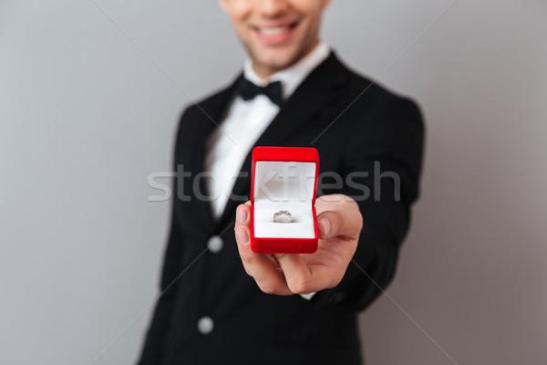 Portret glimlachend man smoking tonen Stockfoto © deandrobot