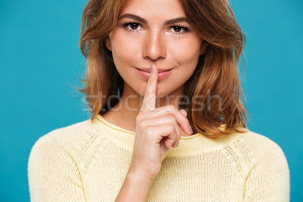 Close up view of Smiling mystery woman in sweater Stock photo © deandrobot