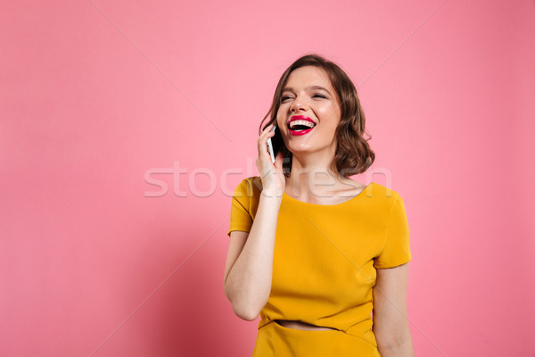 Portrait of a young happy woman in dress Stock photo © deandrobot