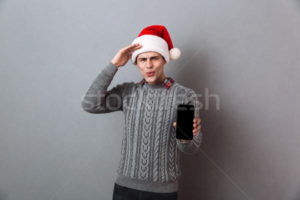 Fiatal jóképű érzelmes férfi visel karácsony Stock fotó © deandrobot