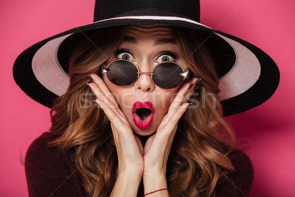 Shocked lady wearing hat and sunglasses Stock photo © deandrobot