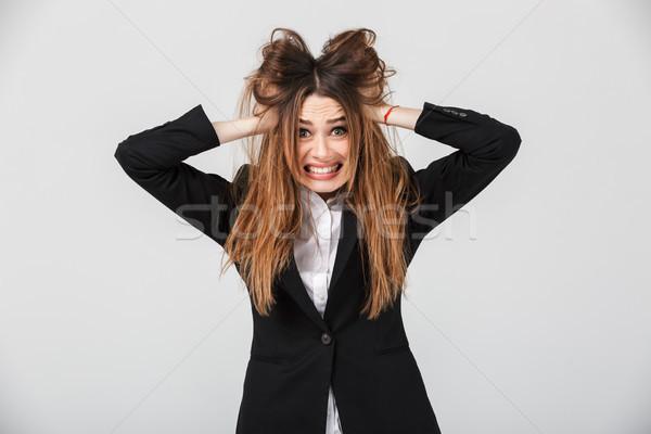 Ritratto confusi imprenditrice suit capelli Foto d'archivio © deandrobot