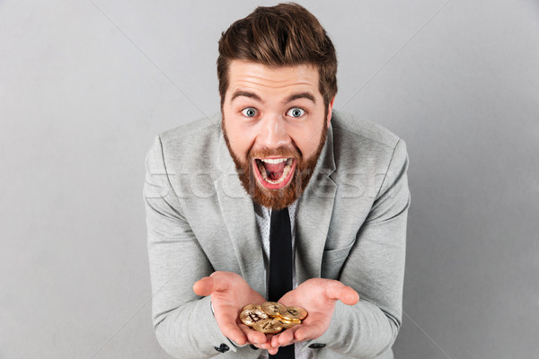 Portrait of an excited businessman Stock photo © deandrobot