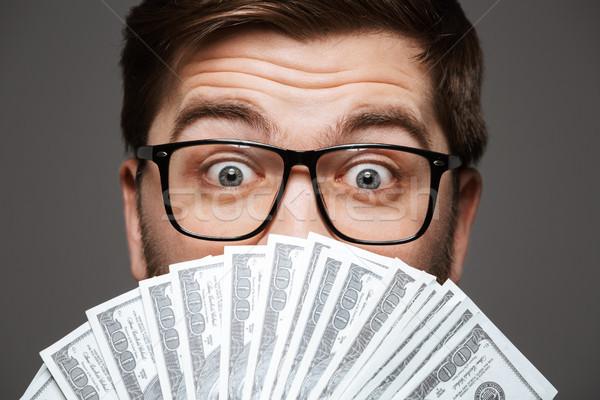 Close up portrait of a happy young businessman Stock photo © deandrobot