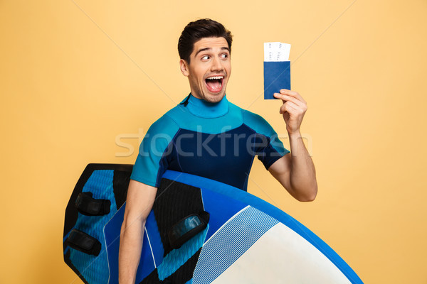 Portrait of a happy young man dressed in swimsuit Stock photo © deandrobot