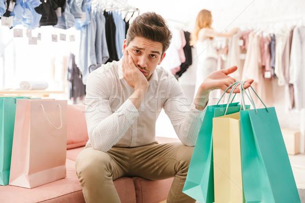 Vervelen man vriendin winkelen Stockfoto © deandrobot