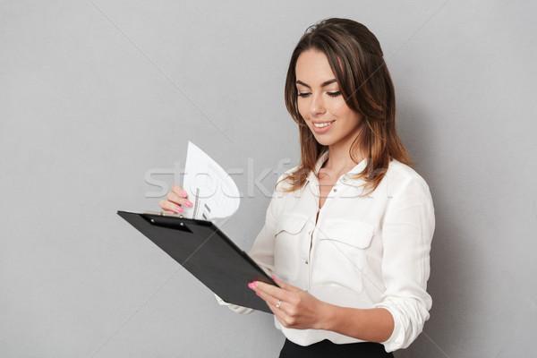 Incroyable jeunes femme d'affaires presse-papiers Photo stock © deandrobot