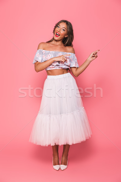 Full length portrait of excited european woman 20s in beautiful  Stock photo © deandrobot