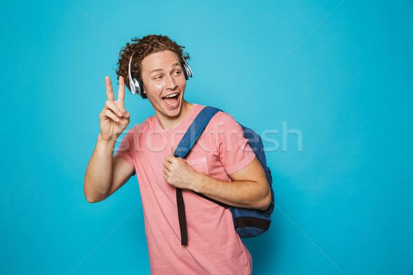 Portrait positif homme cheveux bouclés sac à dos Photo stock © deandrobot