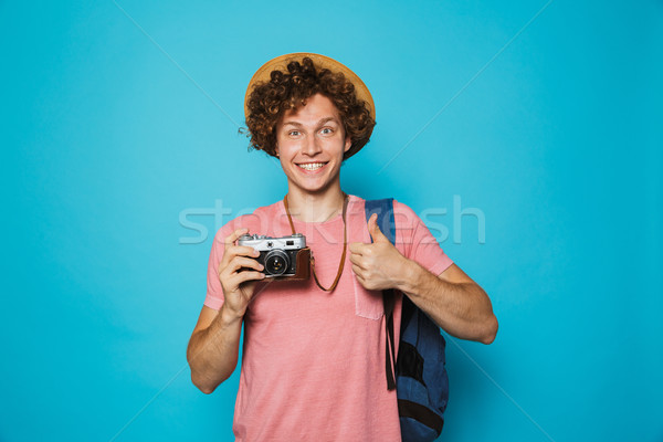 Photo of caucasian young man 18-20 with curly hair wearing backp Stock photo © deandrobot