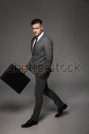 Portrait affaires permanent portable gris fond Photo stock © deandrobot
