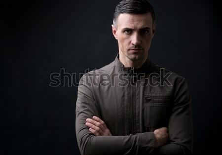 Retrato feliz hombre pie armas doblado Foto stock © deandrobot