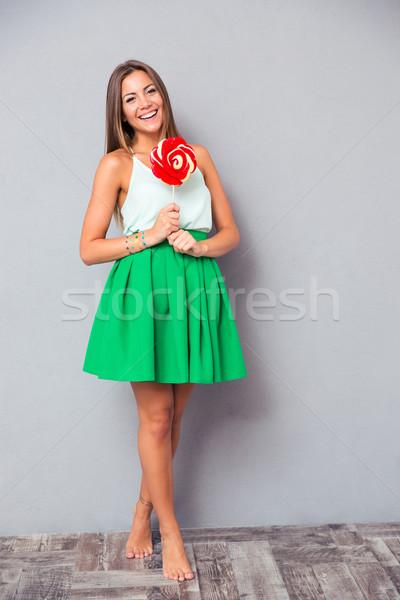 Glimlachend meisje permanente lolly portret Stockfoto © deandrobot