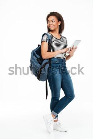 Female student reading book  Stock photo © deandrobot
