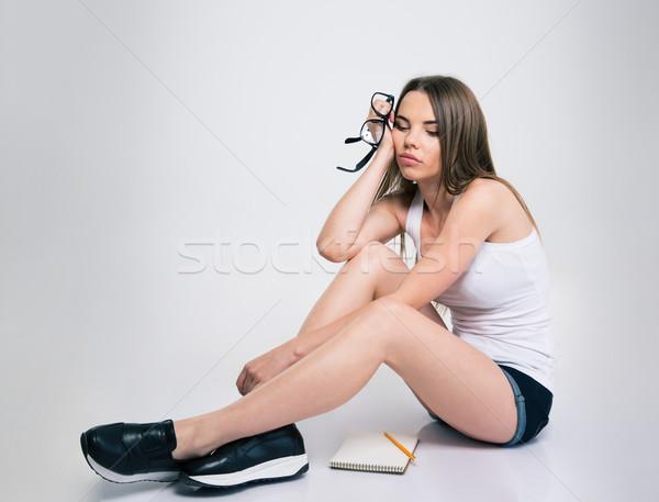 Nudzić kobiet student posiedzenia piętrze portret Zdjęcia stock © deandrobot
