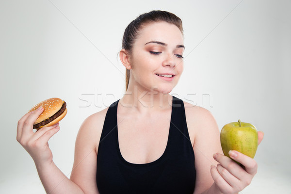 Tłuszczu kobieta burger jabłko portret Zdjęcia stock © deandrobot