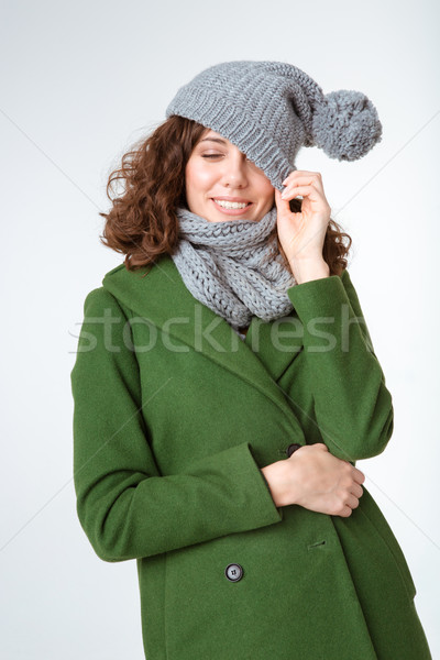 Happy woman in winter cloth and closed eyes Stock photo © deandrobot