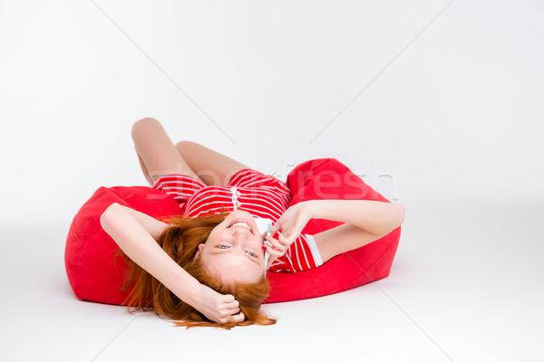 Animado mulher falante celular bastante Foto stock © deandrobot