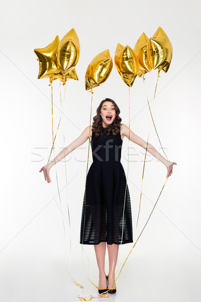 Charming elated happy young curly woman celebrate her birthday Stock photo © deandrobot