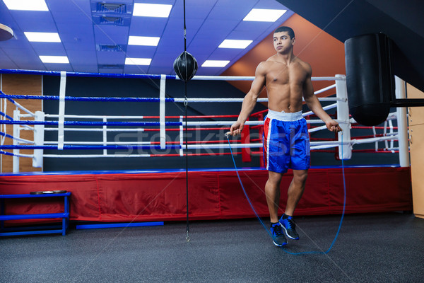 Boxer jumping with skipping rope  Stock photo © deandrobot