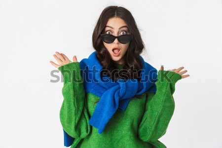 Playful pretty young woman in round sunglasses pointing on herself  Stock photo © deandrobot