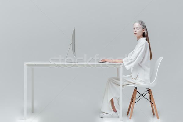Lány ül asztal számítógép pc divat Stock fotó © deandrobot