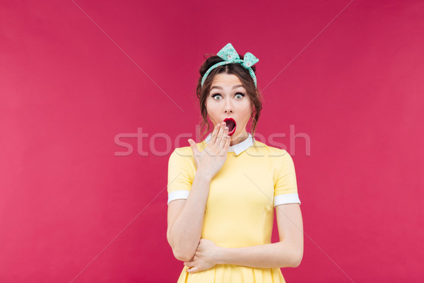 Amazed pretty pinup girl standing with mouth opened Stock photo © deandrobot