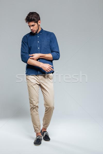 Teljes alakos portré jóképű komoly férfi izolált Stock fotó © deandrobot
