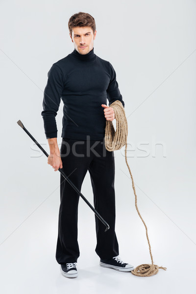 Full length of man offender with rope and crowbar Stock photo © deandrobot