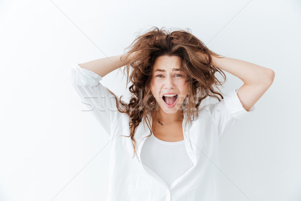 Young brunette woman with long hair shouting Stock photo © deandrobot