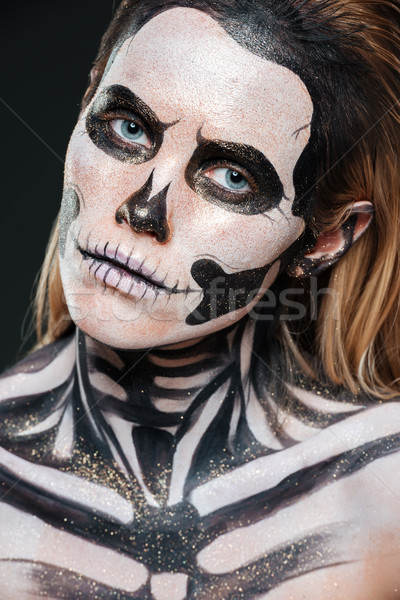 Closeup of woman with scared gothic makeup Stock photo © deandrobot