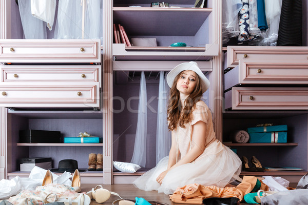 Girl choosing clothes in her wardrobe Stock photo © deandrobot