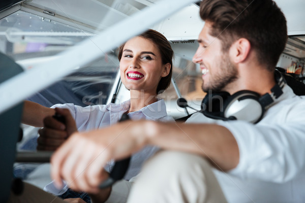Couple sitting in cabine of small airplane Stock photo © deandrobot