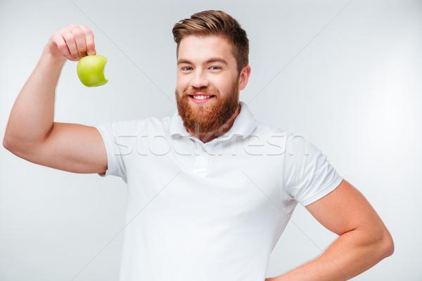 портрет красивый мужчина бицепс яблоко Сток-фото © deandrobot