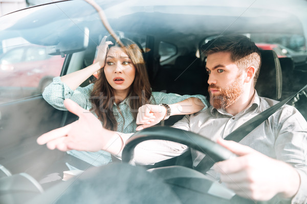 Couple have a dispute in car Stock photo © deandrobot