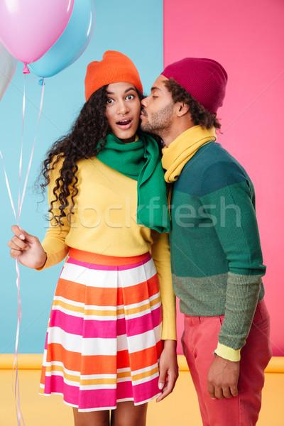 Tenero african uomo piedi bacio fidanzata Foto d'archivio © deandrobot