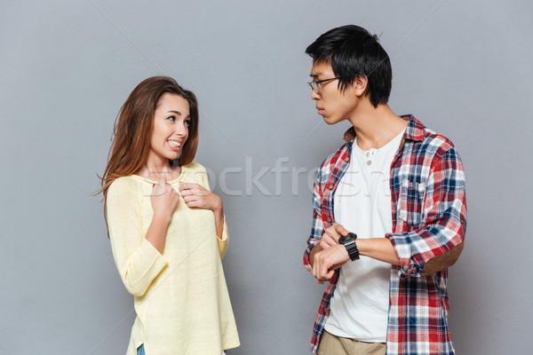 Young interracial couple being late because of the woman Stock photo © deandrobot