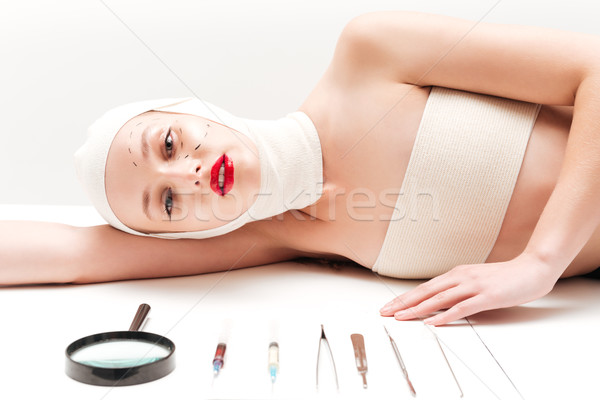 Woman in bandages lying Stock photo © deandrobot